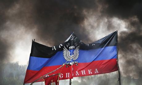 Smoke rises around the flag of the self-proclaimed Donetsk republic