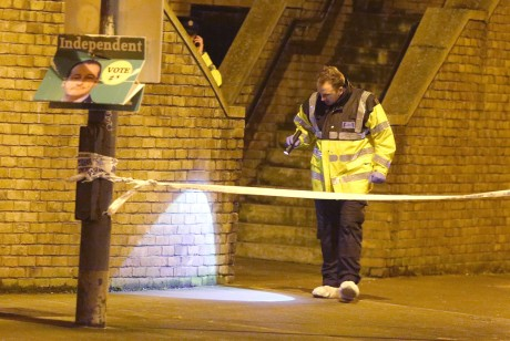 A Garda checks for evidence at Poplar Row where a man was shoot dead. Picture credit; Damien Eagers 8/2/2016